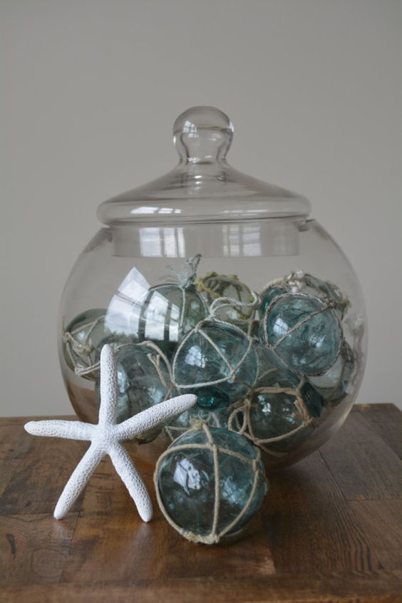 a large jar with fishing floats will be an original decoration