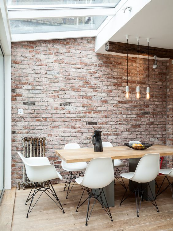 an industrial dining space with skylights is filled with daylight