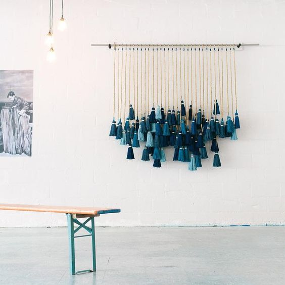 an ombre teal, turquoise and aqua tassel wall hanging will remind you of the seaside