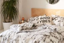 10 black and white marble bedding and a copper mirror make the bedroom really chic