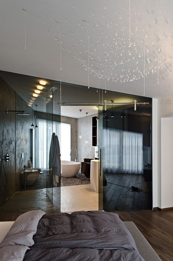 separate the en-suite bathroom from your bedroom with smoked glass doors to keep both spaces light-filled and connected