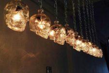 10 skull pendant lights on chains make up a unique chandelier