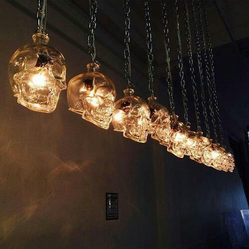 skull pendant lights on chains make up a unique chandelier