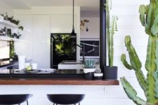 11 a desert-inspired space with a dark-stained windowsill and black modern stools