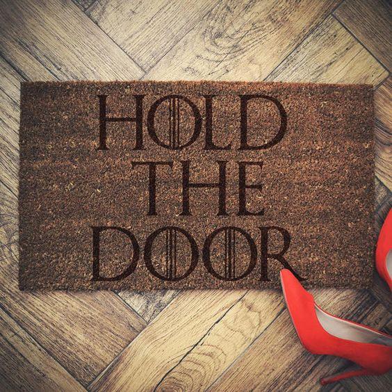 a door mat with famous 'Hold the door' print
