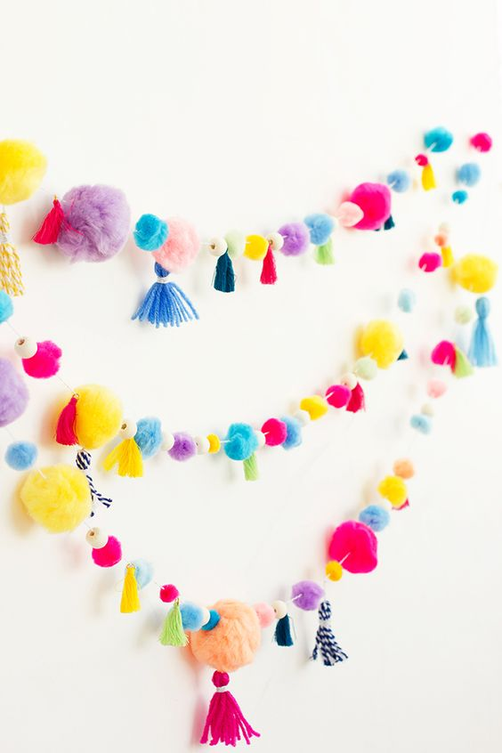 a super colorful pompom and tassel garland will cheer up any space