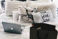 11 add a chic touch to your bed with a marble and a fur pillow