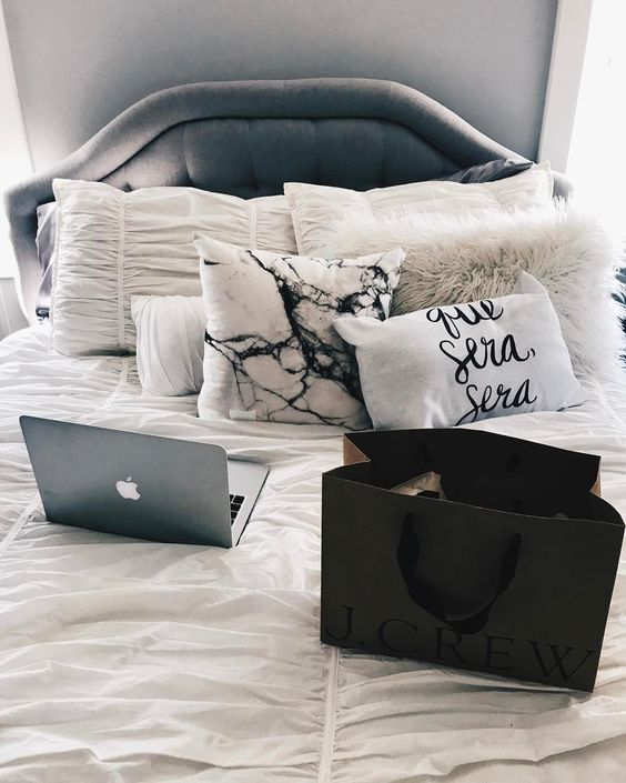 add a chic touch to your bed with a marble and a fur pillow