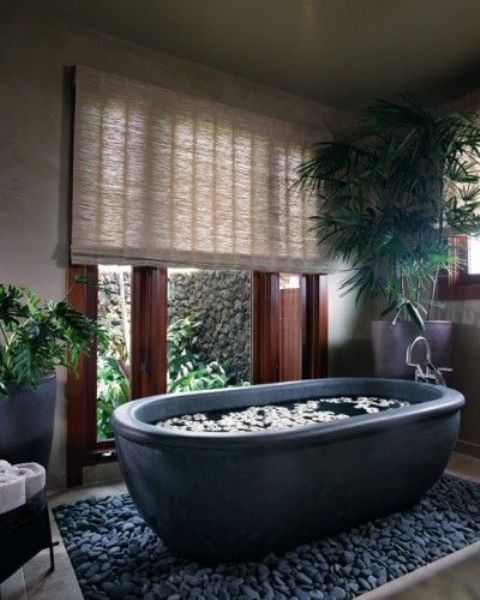 place your bathtub into large pebbles and you'll immediately get a spa feel