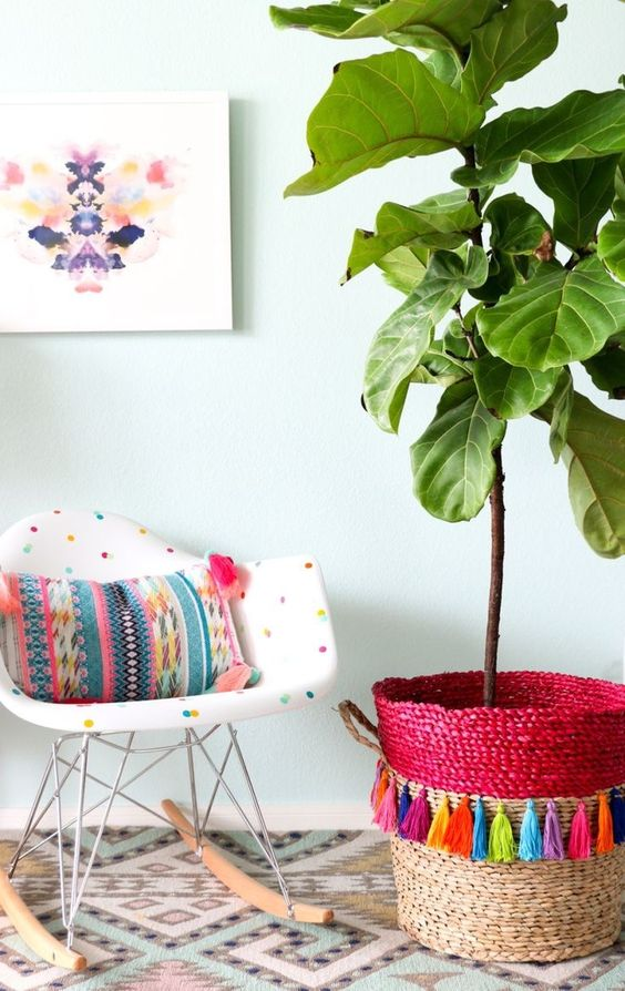 a bold basket with colorful tassels can be a nice cover for a usual planter