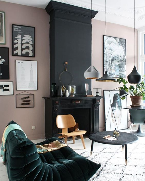a dark green velvet bean bag chair accentuates the blush and black space