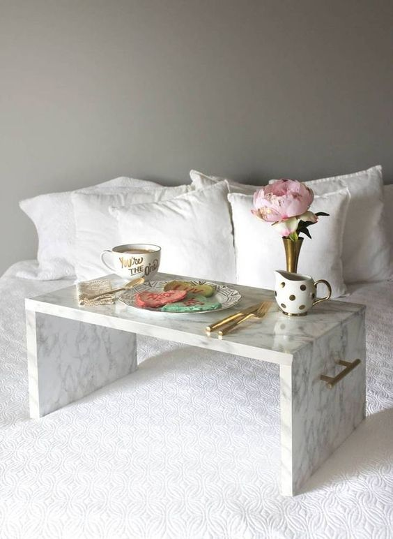a marble contact paper tray with metallic handles is amazing for serving breakfast to your love