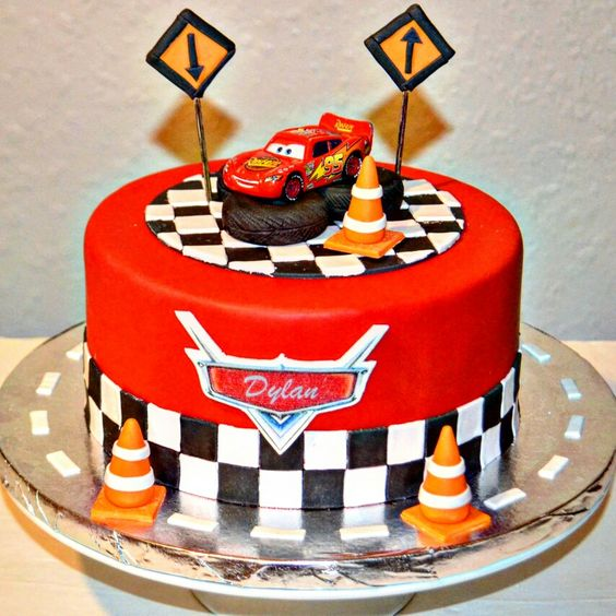 a red, black and white birthday cake inspired by Cars