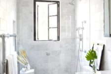 12 a white marble bathroom with a shower window – enjoy the views while keeping privacy