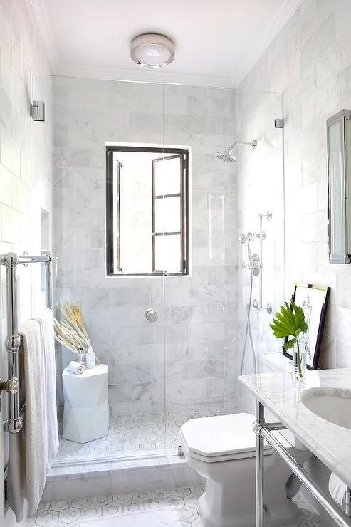A White Marble Bathroom With A Shower Window   Enjoy The Views While  Keeping Privacy