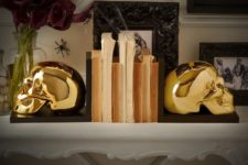12 gilded skull book ends will add a dramatic yet glam touch to the space