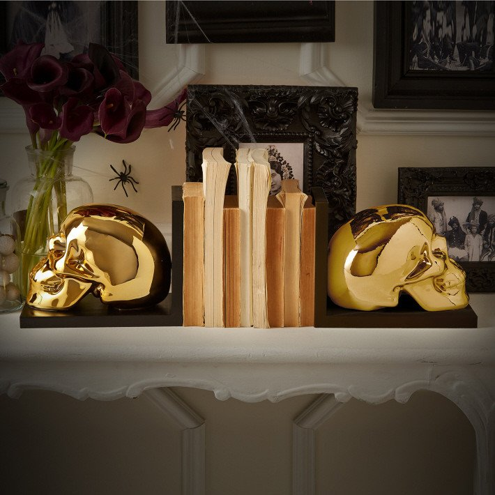 gilded skull book ends will add a dramatic yet glam touch to the space