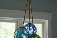 12 glass fishing float cluster pendant light for a beach home