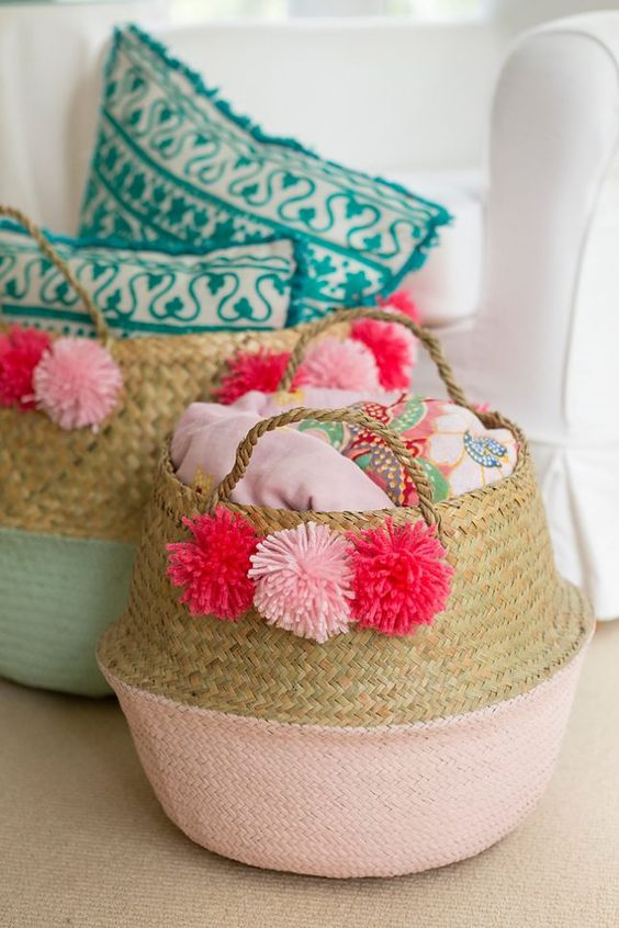 a basket for linen with colorful pompoms to make them more summer-like