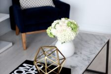 13 a marble-inspired coffee tabletop adds interest to the space