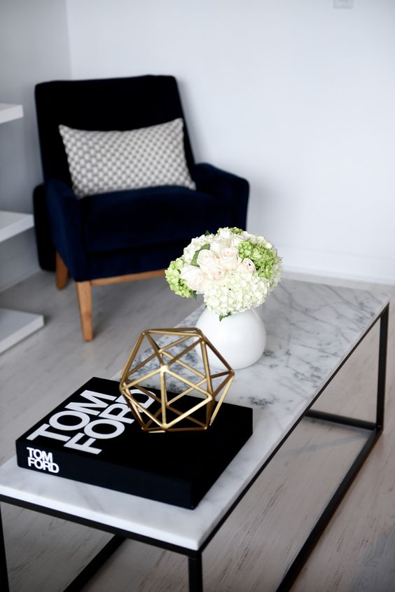 a marble-inspired coffee tabletop adds interest to the space