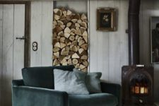 13 a teal velvet armchair will stand out in a rustic interior and will make sitting by the fire cozier
