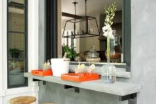 13 an industrial space with a concrete windowsill, metal and wood stools