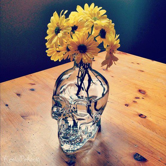 glass skull vase with fresh blooms is an easy way to incorporate a skull into your decor