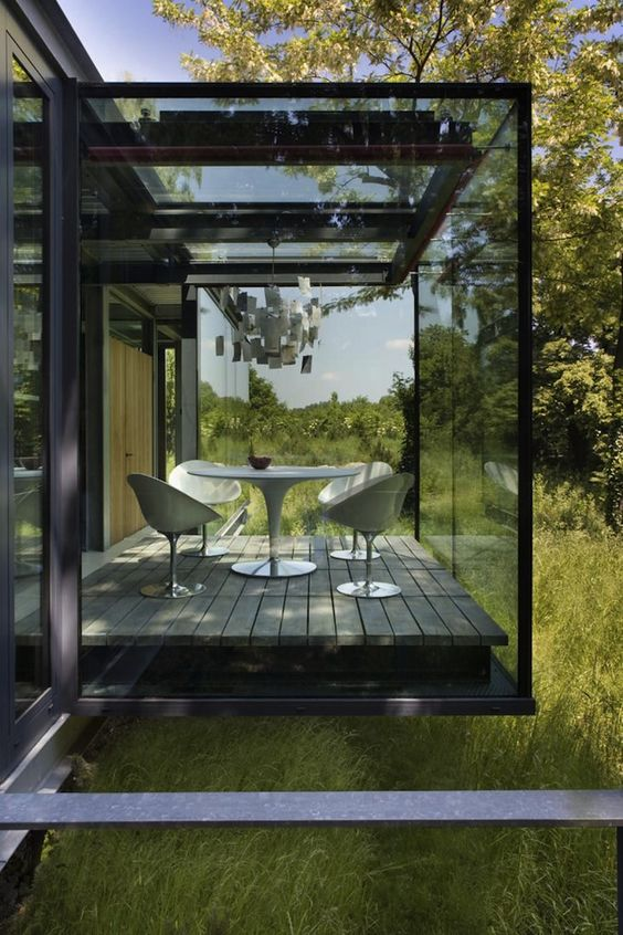 a smoke glass sunroom will keep more privacy and keep you away from the excessive sunlight