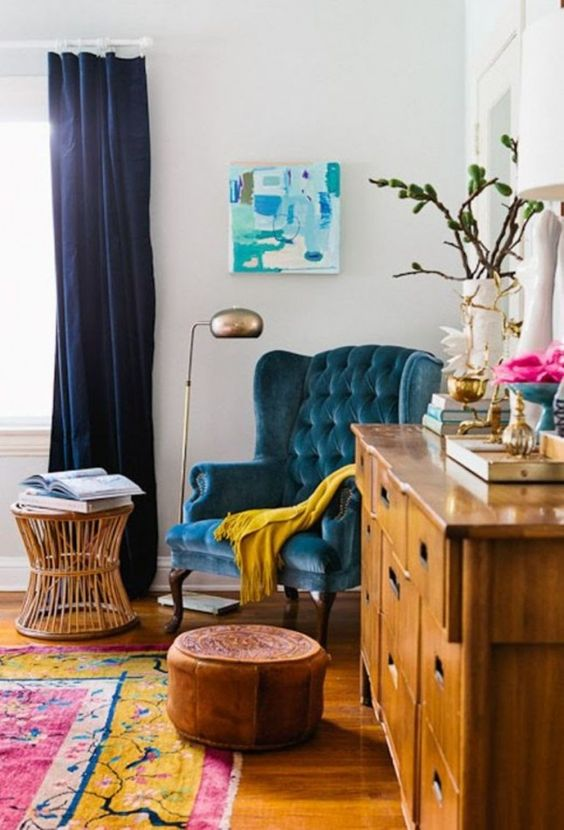 a vintage blue velvet armchair is ideal for a reading nook, you'll never want to leave it