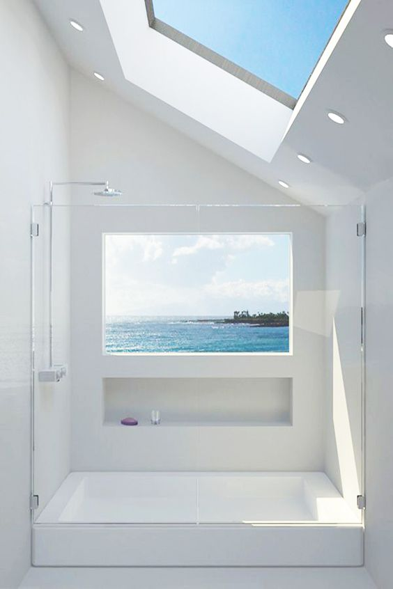all-white shower with skylights and a window with sea views - who needs more