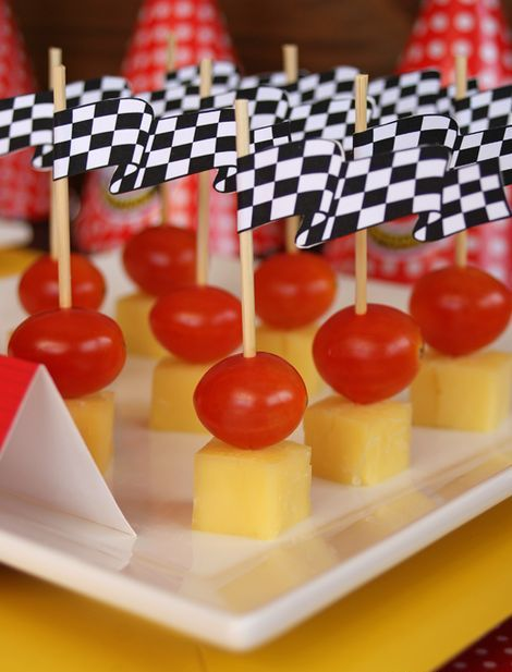 appetizers topped with finish flags are a cool Cars themed starter