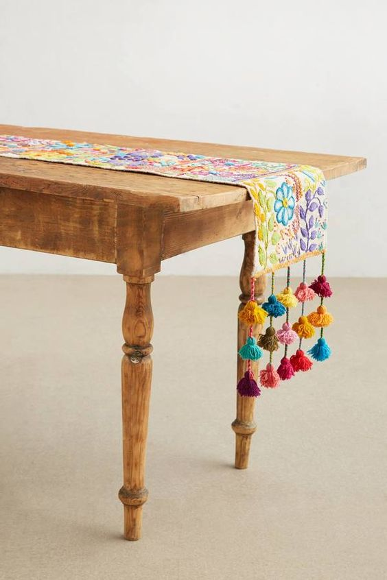 colorful tassel stitch table runner to add a gypsy feel to your interior