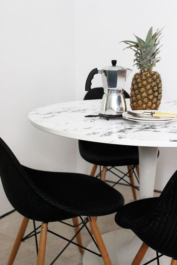 cover a dining table with marble contact paper that fits in the color to make it cool