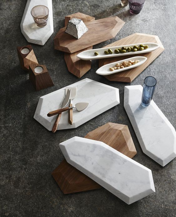 faceted marble and rosewood serving boards look moder, chic and edgy
