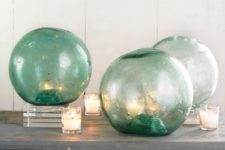 14 oversized fishing floats used as lanterns remind of giant glass bubbles
