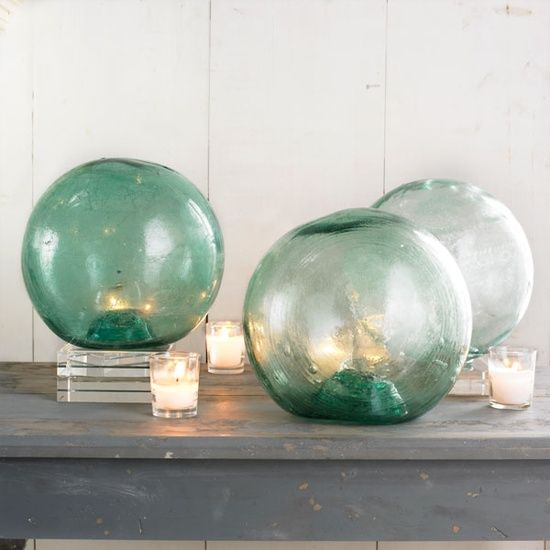 oversized fishing floats used as lanterns remind of giant glass bubbles