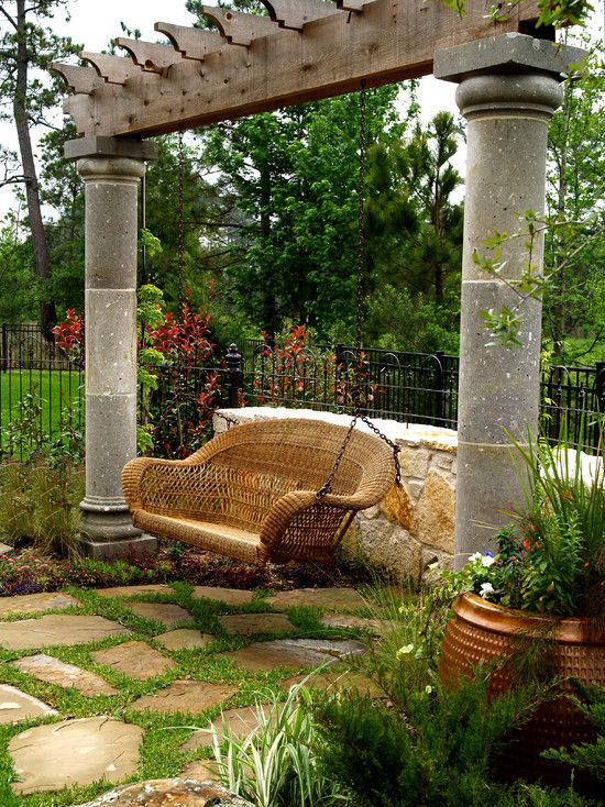 an arch with a traditional rattan swing can be interwoven with flowers and vines