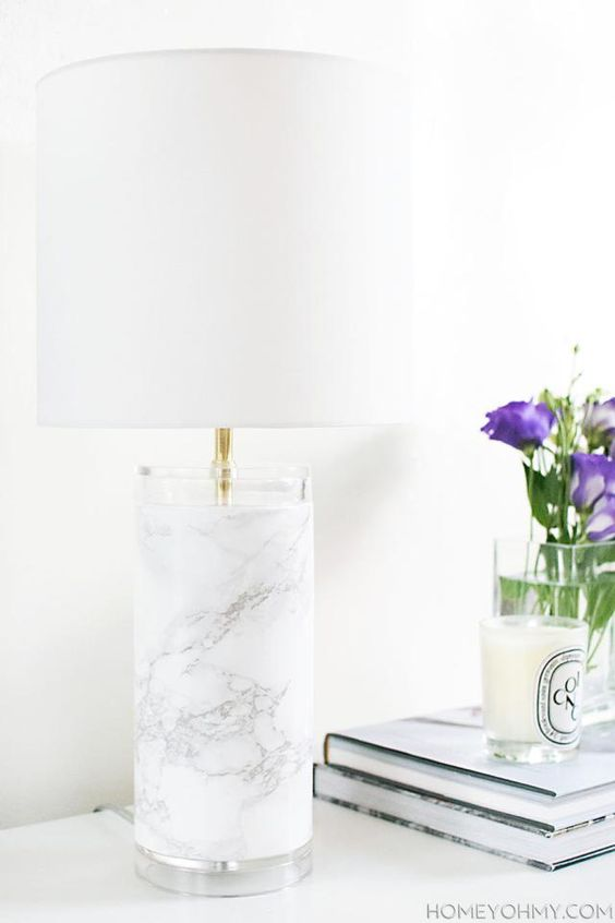 cover a usual lamp base with marble contact paper to achieve a chic look
