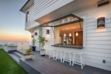 15 garage-style window and a small eating space outdoors