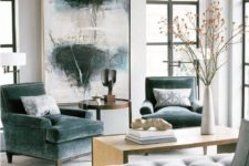 15 grey green velvet armchairs make this modern space more refined and give it a chic feel