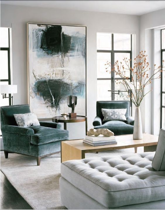 grey green velvet armchairs make this modern space more refined and give it a chic feel