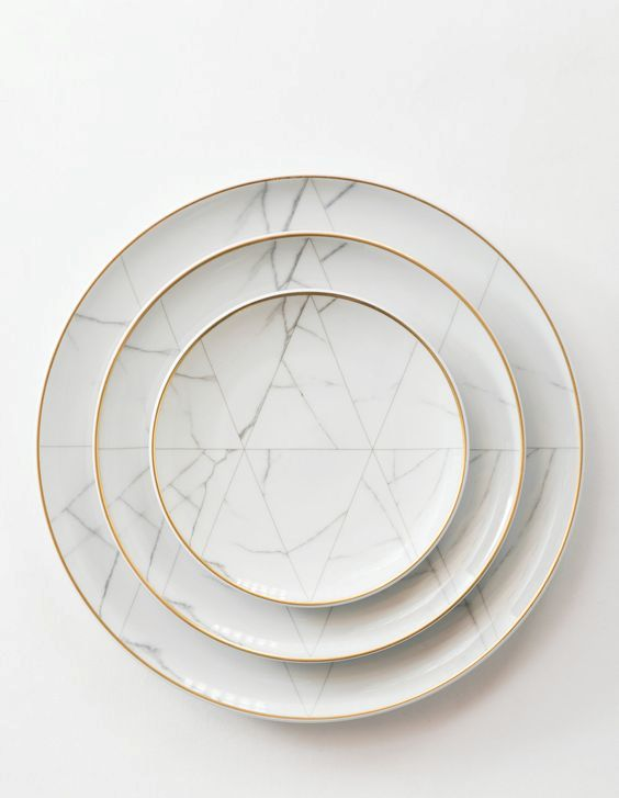 marble-inspired dinnerware with a gilded edge will make any meal special