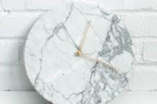 take a usual clock, cover it with marble wallpaper and change detailing for metallic
