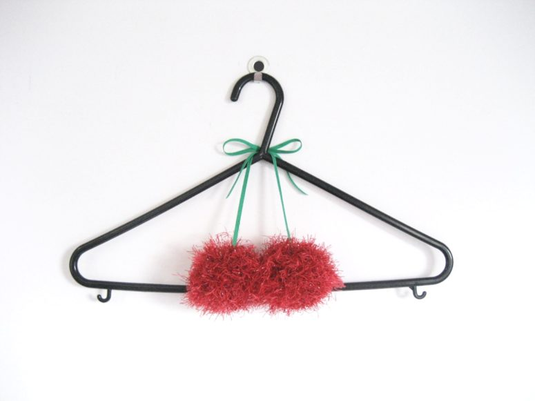 DIY scented cherry pompoms for clothes hangers (via adorablest.com)
