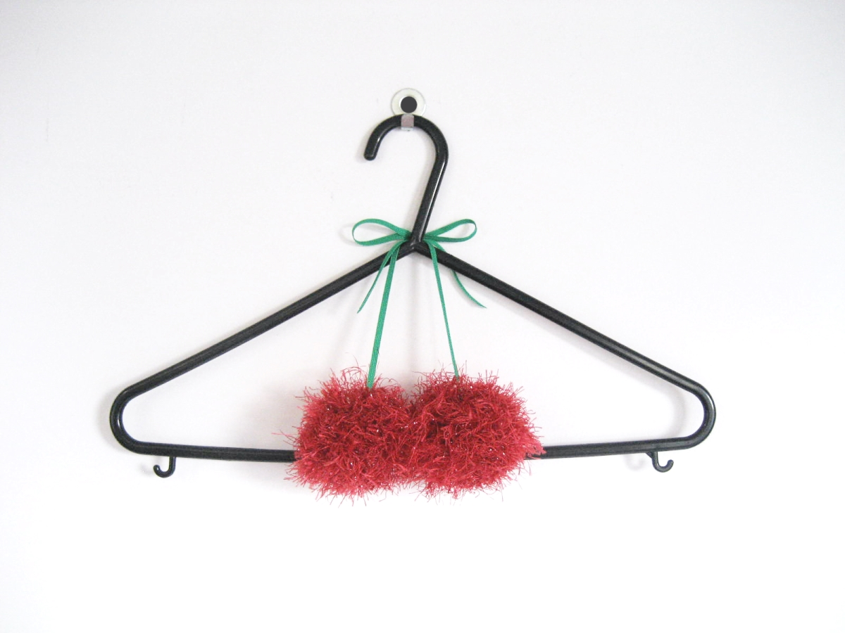 DIY scented cherry pompoms for clothes hangers