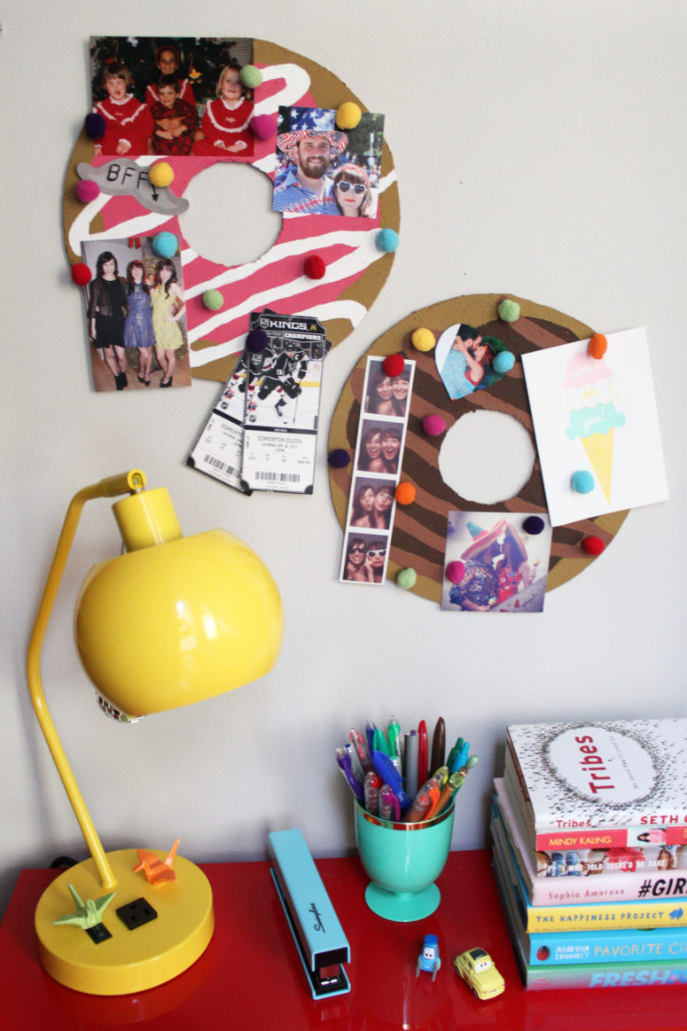 DIY donut bulletin board with pompom pushpins (via www.paintthegownred.com)