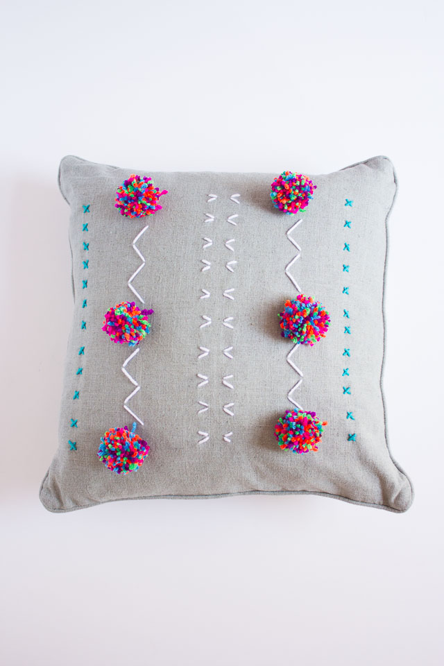 DIY embroidered and pompom pillows (via www.designimprovised.com)