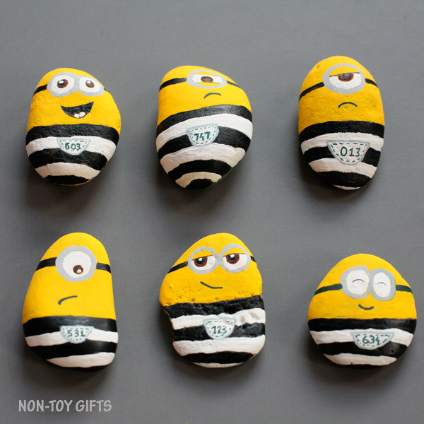 DIY minions in jail of painted rocks
