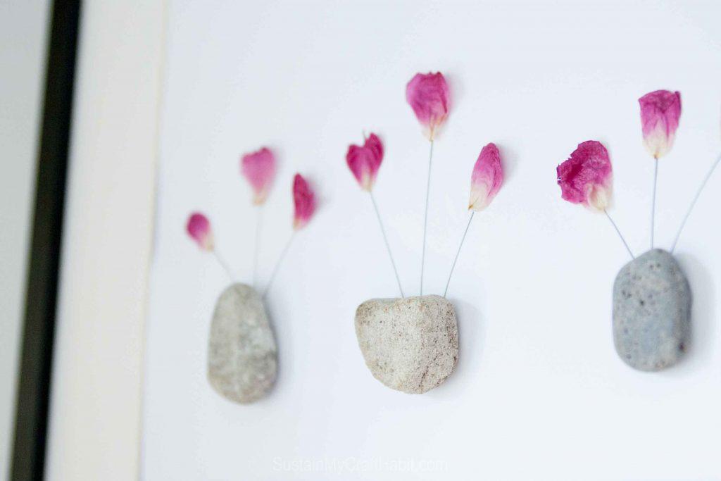 DIY pressed petals and rock art piece